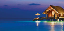 One & Only Reethi Rah - water villa at night